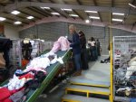 the initial sorting of the clothes when they arrive at the factory
